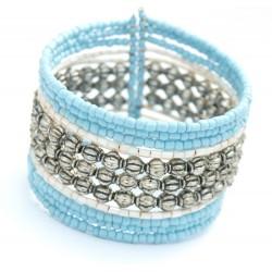 Gros bracelet rigide en perles bleus, blanches et métal