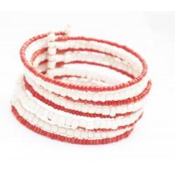 Bracelet rigide en perles oranges et blanches